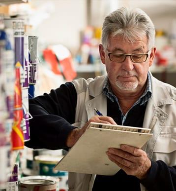 Senior Man Taking Inventory